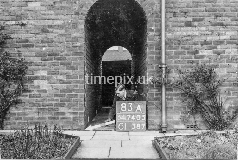 SD740583A1, Man marking Ordnance Survey minor control revision point with an arrow in 1940s