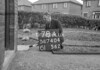 SD740478A, Man marking Ordnance Survey minor control revision point with an arrow in 1940s
