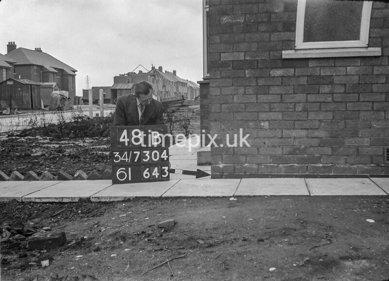SD730448B, Man marking Ordnance Survey minor control revision point with an arrow in 1940s