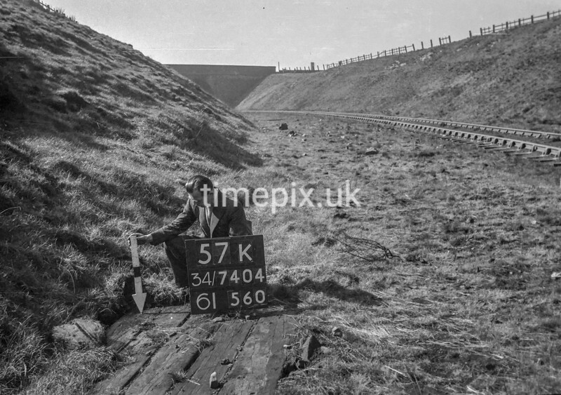 SD740457K, Man marking Ordnance Survey minor control revision point with an arrow in 1940s
