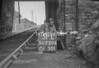 SD730451L, Man marking Ordnance Survey minor control revision point with an arrow in 1940s