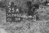 SD740325A, Man marking Ordnance Survey minor control revision point with an arrow in 1940s