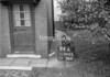 SD740594A, Man marking Ordnance Survey minor control revision point with an arrow in 1940s