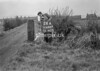 SD740726A, Man marking Ordnance Survey minor control revision point with an arrow in 1940s