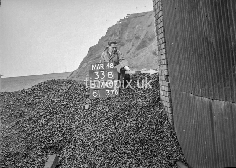 SD740733B, Man marking Ordnance Survey minor control revision point with an arrow in 1940s