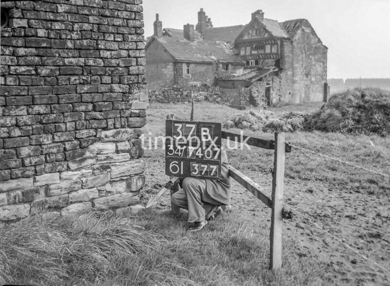 SD740737B, Man marking Ordnance Survey minor control revision point with an arrow in 1940s