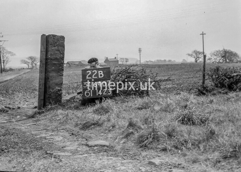 SD740722B1, Man marking Ordnance Survey minor control revision point with an arrow in 1940s