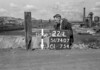 SD740722L1, Man marking Ordnance Survey minor control revision point with an arrow in 1940s