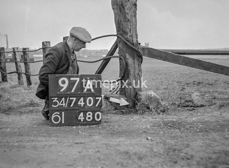 SD740797A2, Man marking Ordnance Survey minor control revision point with an arrow in 1940s