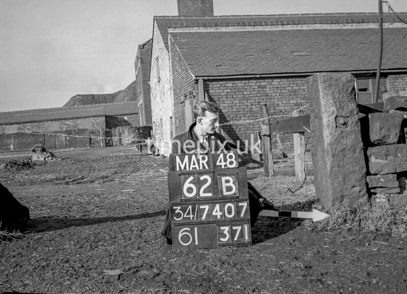 SD740762B, Man marking Ordnance Survey minor control revision point with an arrow in 1940s