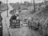 SD740798A2, Man marking Ordnance Survey minor control revision point with an arrow in 1940s