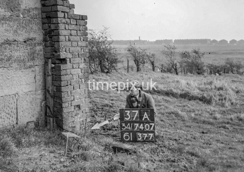 SD740737A, Man marking Ordnance Survey minor control revision point with an arrow in 1940s