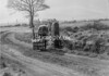 SD740714B2, Man marking Ordnance Survey minor control revision point with an arrow in 1940s