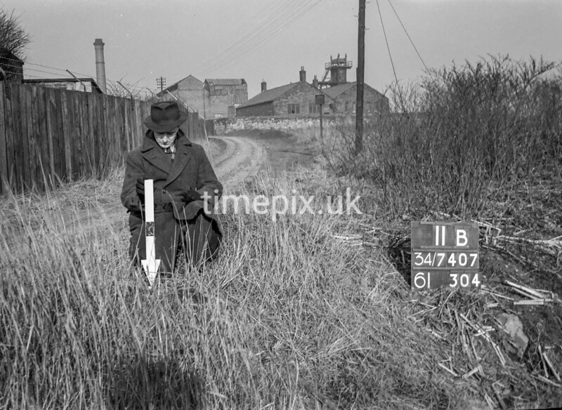 SD740711B, Man marking Ordnance Survey minor control revision point with an arrow in 1940s