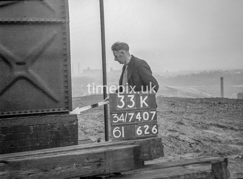 SD740733K, Man marking Ordnance Survey minor control revision point with an arrow in 1940s