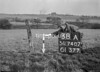 SD740738A, Man marking Ordnance Survey minor control revision point with an arrow in 1940s