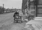 SD730274L, Man marking Ordnance Survey minor control revision point with an arrow in 1940s