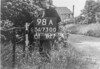 SD730098A, Man marking Ordnance Survey minor control revision point with an arrow in 1940s