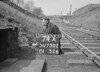 SD730274A, Man marking Ordnance Survey minor control revision point with an arrow in 1940s