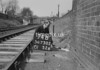SD730274B, Man marking Ordnance Survey minor control revision point with an arrow in 1940s