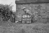 SD730228B, Man marking Ordnance Survey minor control revision point with an arrow in 1940s