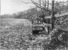 SD730039A, Man marking Ordnance Survey minor control revision point with an arrow in 1940s
