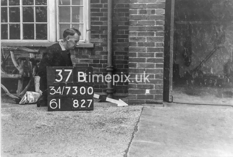 SD730037B, Man marking Ordnance Survey minor control revision point with an arrow in 1940s