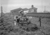 SD730296A, Man marking Ordnance Survey minor control revision point with an arrow in 1940s