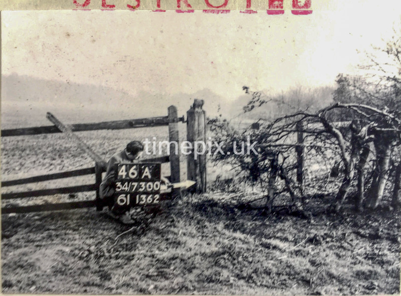 SD730046A, Man marking Ordnance Survey minor control revision point with an arrow in 1950s