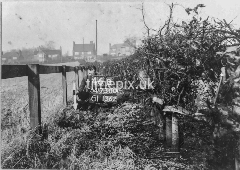 SD730046B, Man marking Ordnance Survey minor control revision point with an arrow in 1950s