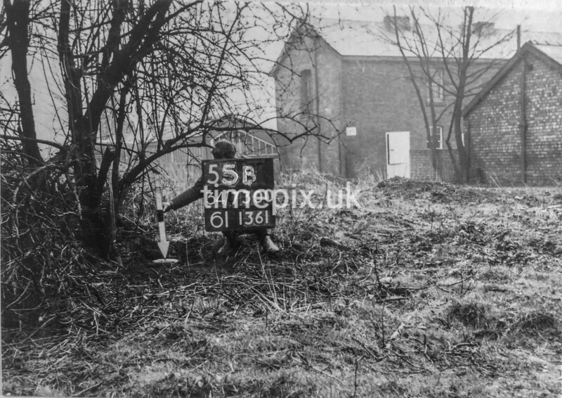 SD730055B, Man marking Ordnance Survey minor control revision point with an arrow in 1950s