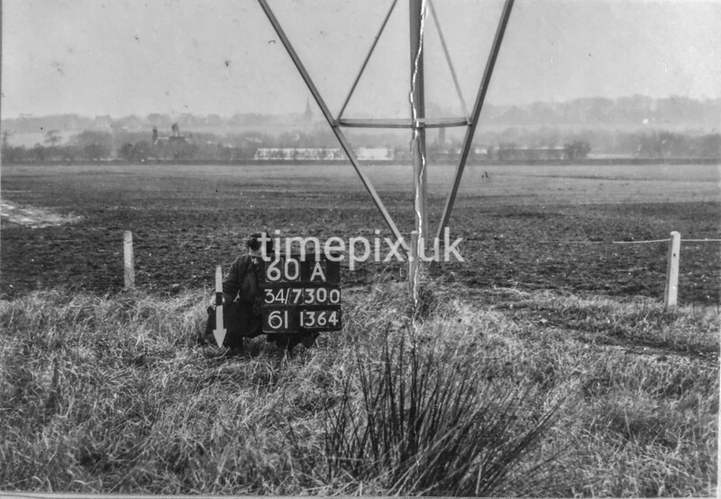 SD730060A, Man marking Ordnance Survey minor control revision point with an arrow in 1950s