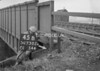 SD730245B, Man marking Ordnance Survey minor control revision point with an arrow in 1940s