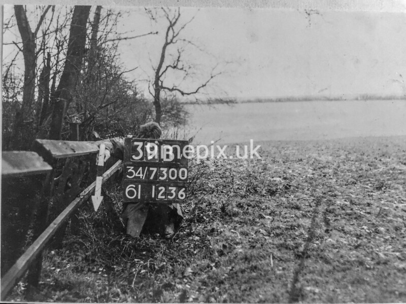 SD730039B, Man marking Ordnance Survey minor control revision point with an arrow in 1940s
