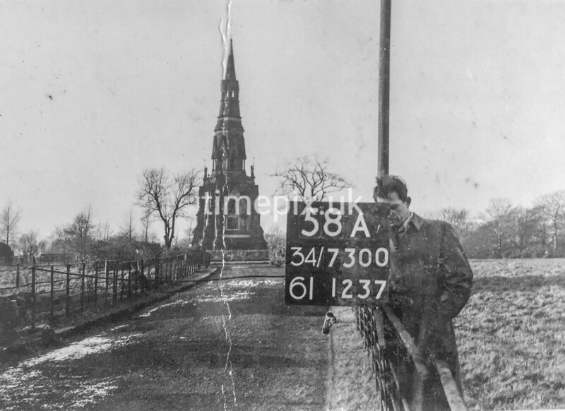 SD730058A, Man marking Ordnance Survey minor control revision point with an arrow in 1940s