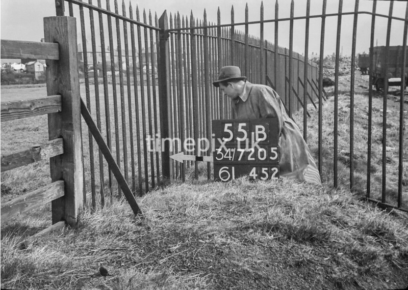 SD720555B, Man marking Ordnance Survey minor control revision point with an arrow in 1950s