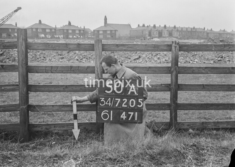SD720550A, Man marking Ordnance Survey minor control revision point with an arrow in 1950s