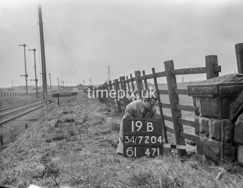 SD720419B, Man marking Ordnance Survey minor control revision point with an arrow in 1950s