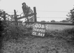 SD690000B, Man marking Ordnance Survey minor control revision point with an arrow in 1950s