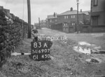 SD690783A, Man marking Ordnance Survey minor control revision point with an arrow in 1950s
