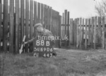 SD690688B, Man marking Ordnance Survey minor control revision point with an arrow in 1950s