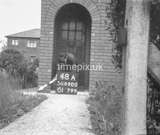 SD690048A, Man marking Ordnance Survey minor control revision point with an arrow in 1950s