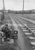 SD720522A, Man marking Ordnance Survey minor control revision point with an arrow in 1950s