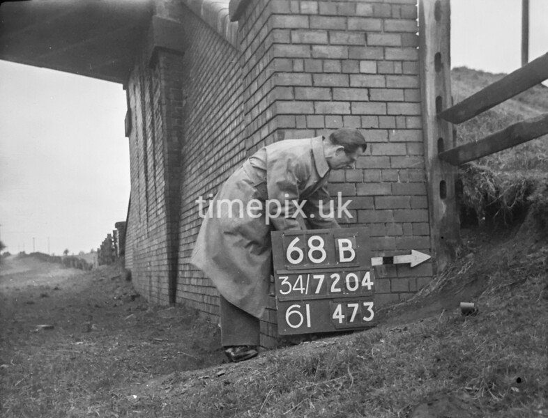 SD720468B, Man marking Ordnance Survey minor control revision point with an arrow in 1950s