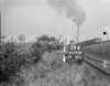 SD720059B, Man marking Ordnance Survey minor control revision point with an arrow in 1950s