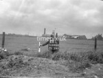 SD690028L, Man marking Ordnance Survey minor control revision point with an arrow in 1950s