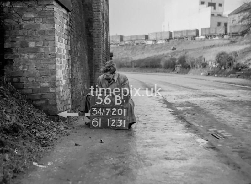 SD720156B, Man marking Ordnance Survey minor control revision point with an arrow in 1950s
