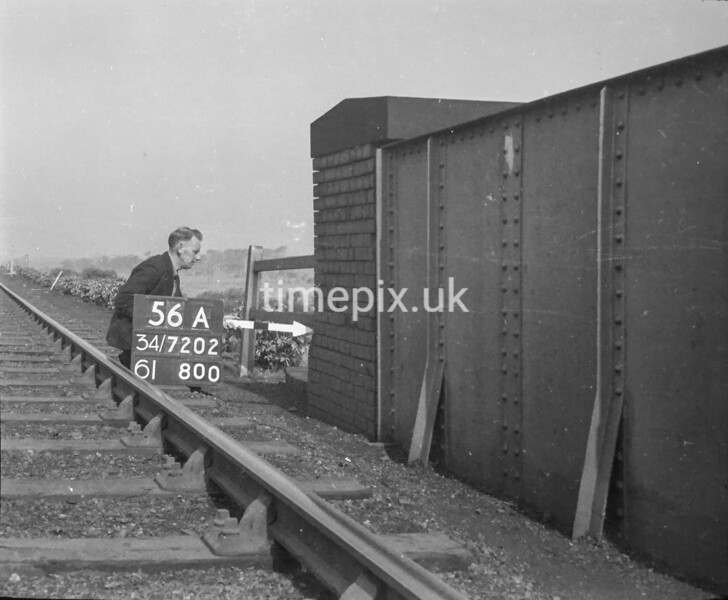 SD720256A, Man marking Ordnance Survey minor control revision point with an arrow in 1950s