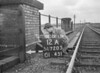 SD720512A, Man marking Ordnance Survey minor control revision point with an arrow in 1950s