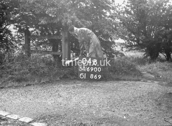 SD690004B, Man marking Ordnance Survey minor control revision point with an arrow in 1950s